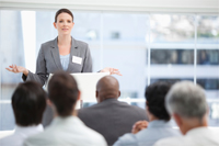 Woman speaking in front of a group of people